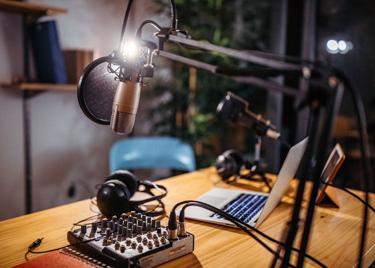 Appraisal podcast studio setup with microphone, laptop, and audio equipment