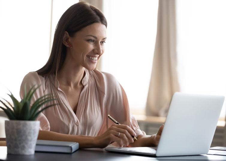 Woman studying for the real estate appraisal license exam