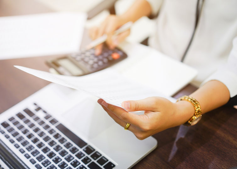 Appraiser using a calculator to account for a superadequacy in a new luxury home