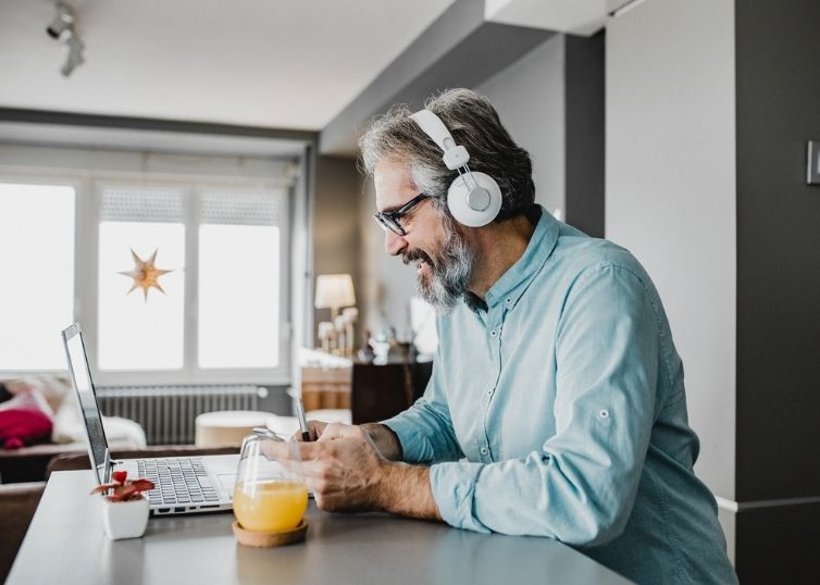 Man participating in online webinar from home